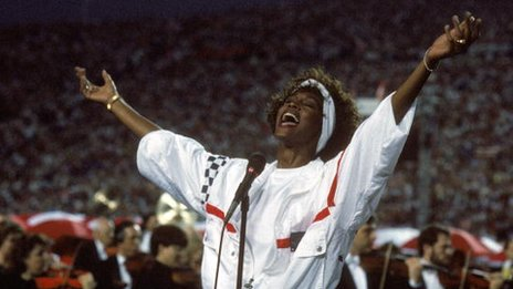 Whitney Houston performs at the Super Bowl in 1991