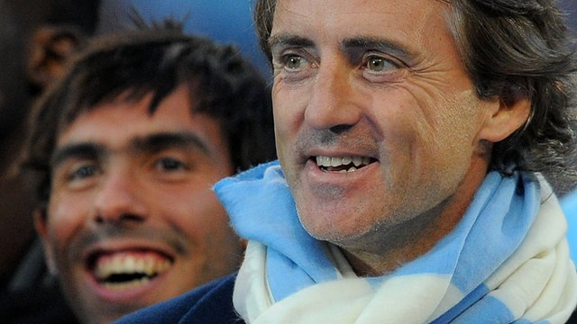 Manchester City&#039;s Carlos Tevez with Roberto Mancini