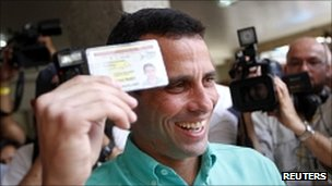 Venezuelan opposition candidate Henrique Capriles smiles as he arrives to vote in Caracas