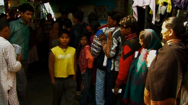 Lining up to register onto India's Unique Identity Number database
