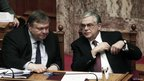 Finance Minister Evangelos Venizelos and Prime Minister Lucas Papademos in parliament before the vote