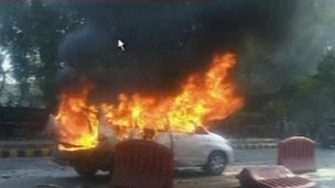Grab from Indian TV showing burning car outside Israeli embassy in Delhi, India - 13 February 2012
