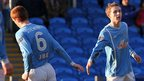 Aaron Stewart and Alan Teggart celebrate