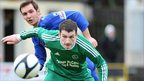 Dungannon's Johnny Topley in action against Newington's Kevin Trainor