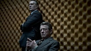 Still from Tinker Tailor Soldier Spy with Gary Oldman and John Hurt (seated)