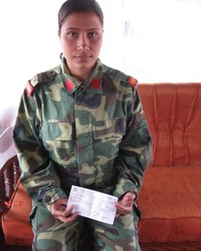 Former Maoist fighter Rohinni with her demobilisation cheque