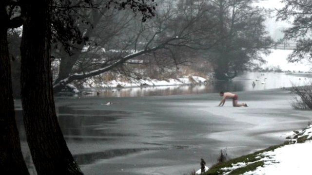 Man crawls over ice on River Stour to rescue dog