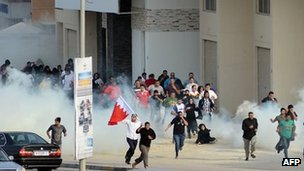 23 January - Bahrain protesters run away from tear gas in Zinj village