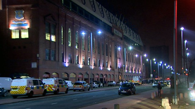 Police vans outside the main stand at Ibrox