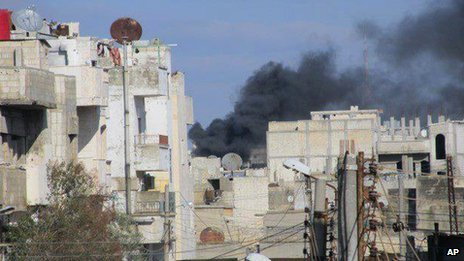 Black smoke is seen rising from the Baba Amr neighbourhood in Homs, Syria, on Sunday Feb. 12, 2012 (image supplied by LCC)