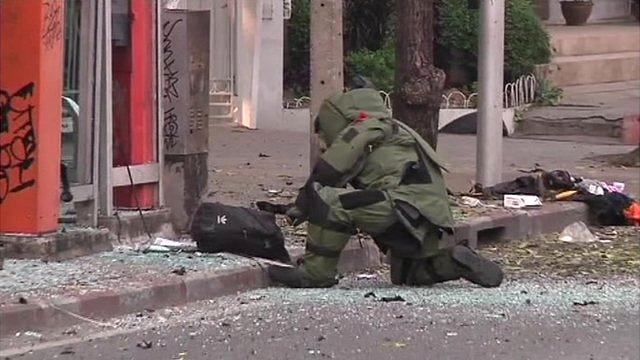 Bomb disposal crew at the site of one of the blasts