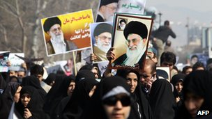 Pro-government demonstrators in Tehran hold up photographs of Ayatollah Ali Khamenei (February 2011)