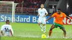 Zambia's Chris Katongo in possession as a Libyan slides past him