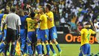 A heavily-bandaged Remy Ebanega offers up his thanks as his Gabonese team-mates celebrates the 97th-minute goal that settled one of the games of the tournament, as the Panthers beat Morocco 3-2 in Group C to knock the Atlas Lions out of the tournament