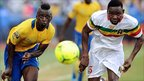 Gabon's Eric Mouloungui (left) and Adama Tamboura of Mali keep the ball in focus as the pair go head-to-head during Sunday's quarter-final in Libreville