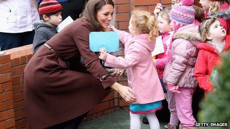 The Duchess of Cambridge greets a young girl as she visits Alder Hey Children's NHS Foundation Trust in Liverpool
