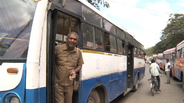 A conductor on a bus in India
