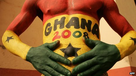 A Ghanaian football with his body painted in the Black Stars' colours at the Africa Nations Cup in February 2008