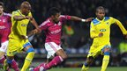 Michel Bastos (centre) challenges for the ball with William (left) and Marcinho