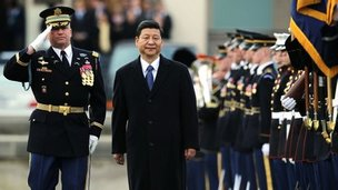 Escorted by US Army Col David Anders (L), Commander of the 3rd Infantry Regiment, Chinese Vice President Xi Jinping inspects the honour guard outside the Pentagon in Arlington, Virginia, 14 Febuary 2012