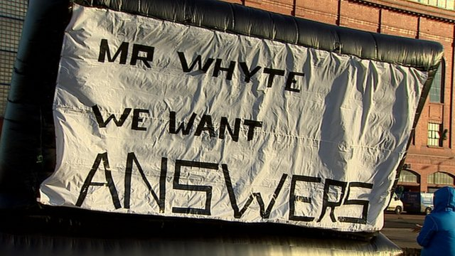 Inflatable balloon with the message 'Mr Whyte we want answers' outside Ibrox