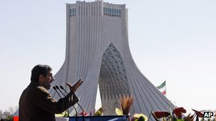 Mahmoud Ahmadinejad speaks near the Azadi (freedom) tower at a rally to mark the 33rd anniversary of Iran's revolution (Feb. 11, 2012)