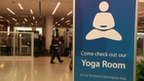 A sign directing travellers to the airport's yoga room