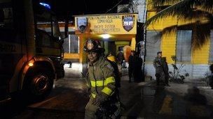 Firemen enter the prison at Comayagua