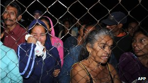 Families wait outside the prison in Comayagua for news