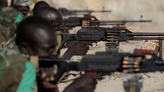 Ugandan Amisom soldiers holding machine guns at a range in one of their bases in Mogadishu