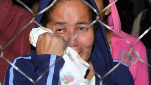 A relatives waits outside the prison in Comayagua for news