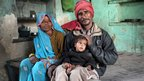 Bangladeshi family in a slum