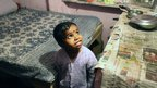 Child in Okhla slum, Delhi, India
