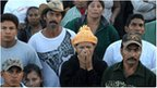 Relatives of inmates wait outside the National Prison compound in Comayagua
