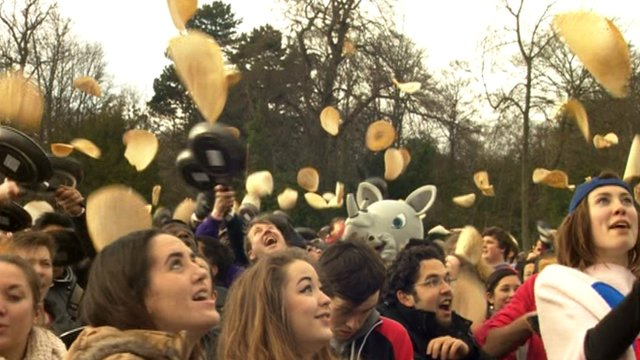 A group of people flipping pancakes in Sheffield