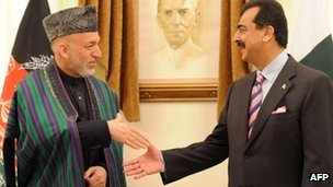 Afghanistan's President Hamid Karzai (left) and Pakistan's Prime Minister Yousuf Raza Gilani in Islamabad on February 16