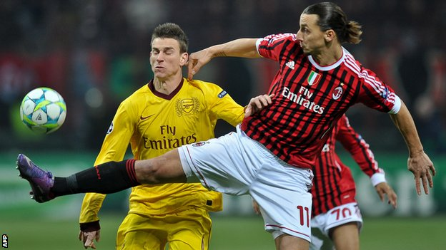 Laurent Koscielny in action against AC Milan's Zlatan Ibrahimovic