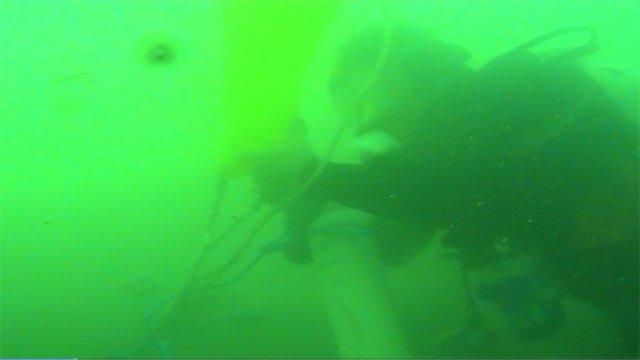A diver explores a Stone Age settlement underneath the sea