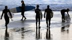 Surfers prepare to enter the water