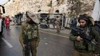 Israeli security forces guard the accident scene
