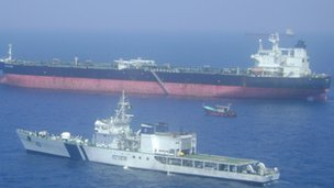 Indian warship alongside the Italian cargo vessel