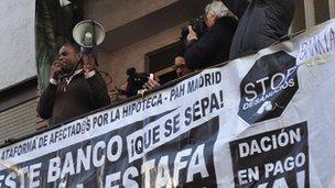 Ronale de la Cruz on balcony holding loud-hailer