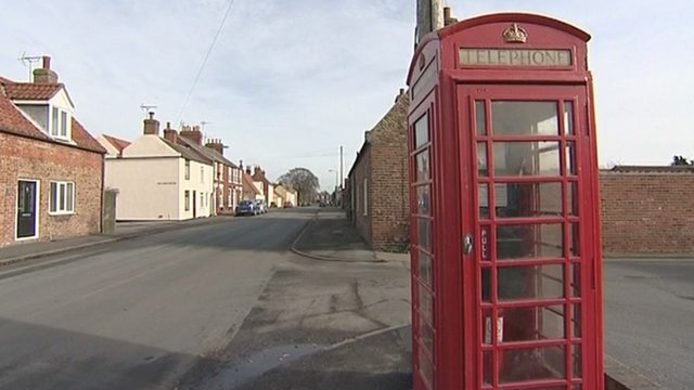 Phone box in village street