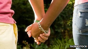 stock image of two people holding hands