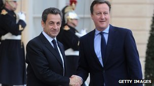 Nicolas Sarkozy greets David Cameron in Paris before meeting in December 2011