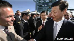Chinese Vice President Xi Jinping, right, shakes hands with Los Angeles City Councilman Joe Buscaino as he tours China Shipping on 16 February, 2012 at the Port of Los Angeles in San Pedro, California