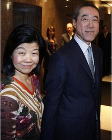 Hong Kong's former chief secretary Henry Tang, right, and his wife Lisa leave a news conference in Hong Kong 16 February, 2012