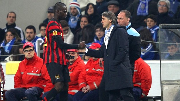 Mario Balotelli is consoled by manager Roberto Mancini