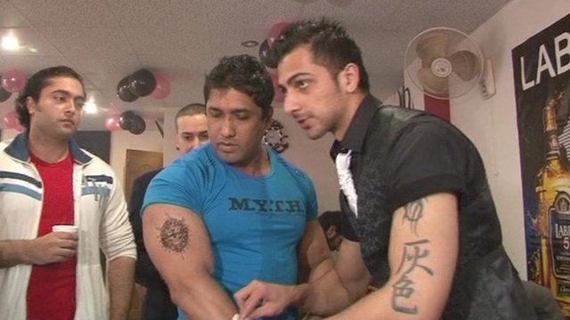Pakistani men getting tattoos