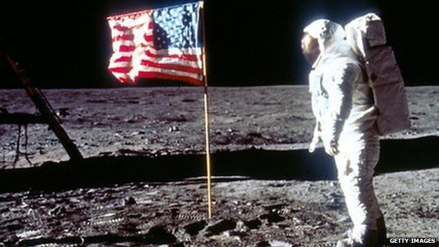 Edwin 'Buzz' Aldrin - the second man to walk on the moon - poses next to the US flag, July 1969